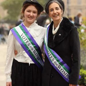 Dr Helen Pankhurst Granddaughter of Emmeline Pankhurst and her daughter Laura Pankhurst wearing a Frosts suffragette sash